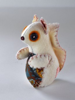 This hand stitched felt squirrel melts by Hill Critters just melts my heart with cuteness.